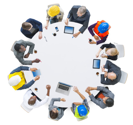 manual job: Group of Business People in a Meeting Stock Photo