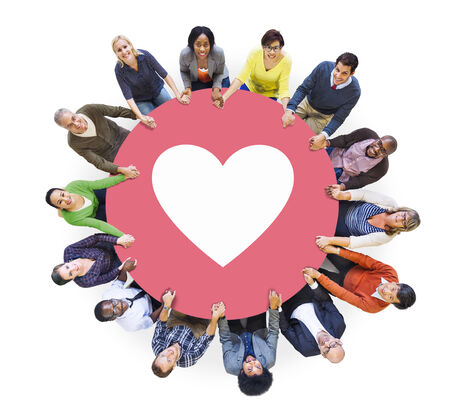 media love: Multiethnic People Holding Hands with Heart Symbol