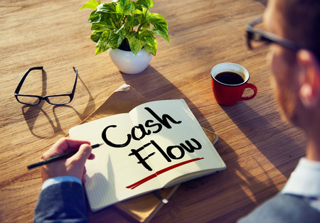 cash flow: Man with a Note and Cash Flow Concept Stock Photo