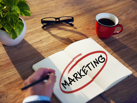 Man with a Note Pad and Marketing Concepts photo