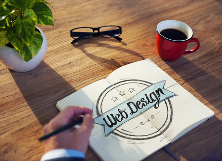 Man with a Note Pad and Web Design Concept photo
