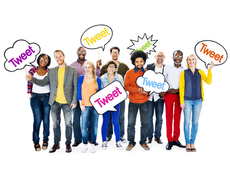 tweet: Group Of Happy Multi-Ethnic People Holding Speech Bubbles With The Word Tweet