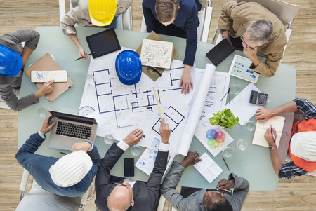 architect plans: Architects and Engineers Planning on a New Project Stock Photo