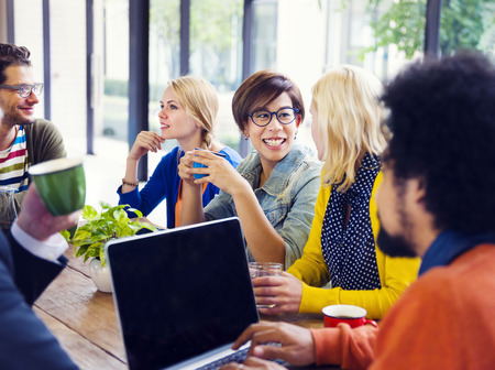 recreational pursuit: Group of friends having a coffee break in a cafe. Stock Photo