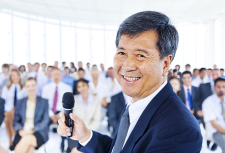 public opinion: Asian Business man as a leader Stock Photo