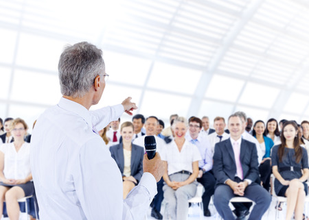 auditorium: Businessman giving presentation to his Colleagues