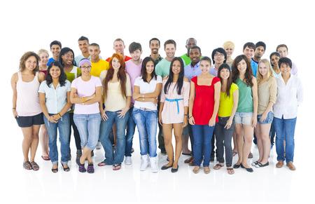Stor grupp av människor som står Stockfoto