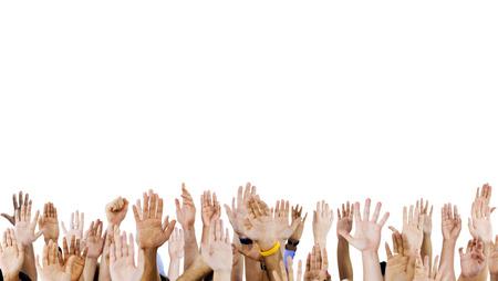 Multi ethnic peoples hands raised. photo