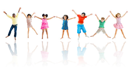 action girl: Group of Children Jumping Stock Photo