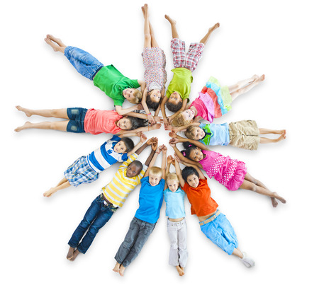 Group of Children Lie Down Stock Photo
