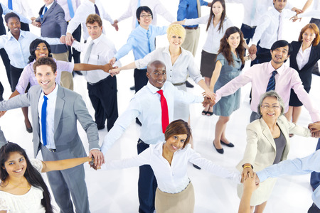 Large Group of Business People Holding Hand Stock Photo