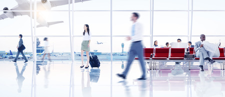 BUSINESSMEN: Group of People in the Airport Stock Photo