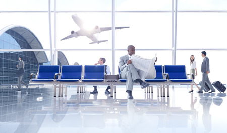 commanding: Group of People in the Airport Stock Photo