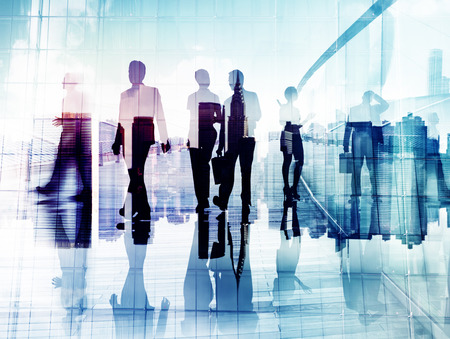 Silhouettes of Business People in Blurred Motion Walking photo