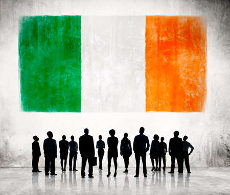 irish pride: Silhouettes of Business People and a Flag of Ireland