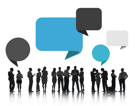 Group of Business People Discussing with Speech Bubbles photo