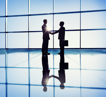 Two Businessmen Handshaking in the Office photo