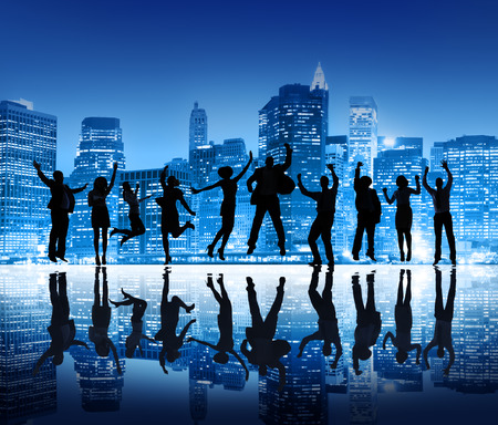 Group Of Happy Business People Silhouettes Jumping For Celebration On Cityscape Background photo