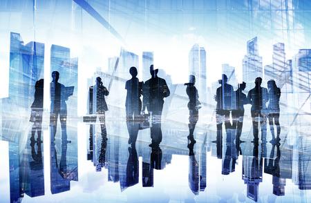 Silhuetter av Business Folkets Busy Day Stockfoto