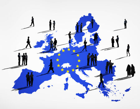 Blue Cartography Of The EU In A White Background And Silhouettes Of Business People On It photo
