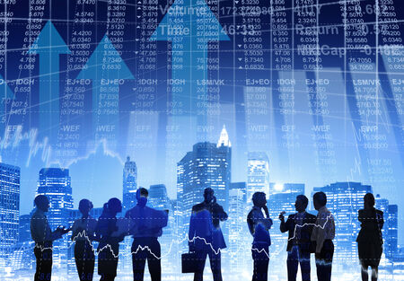 Business People Working Outdoors with Financial Figures photo