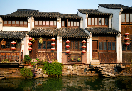 Traditional Chinese houses lining a canal in Suzhou, China. photo