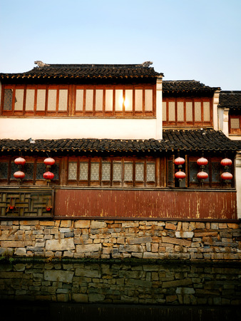 A traditional Chinese canal house basking in the late afternoon sun, Suzhou, China.  photo