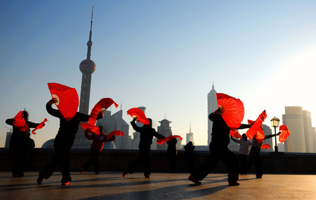 shanghai skyline: Traditional Chinese dance with fans. Stock Photo