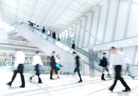 Business People in Asia, Hong Kong. Tilt shift lense with selective focus. Blurred motion. photo