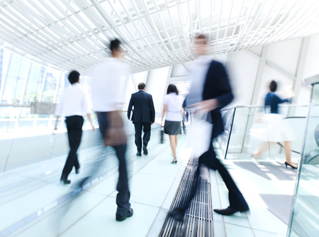 business activity: Business people in Asia. Hong Kong. Tilt shift lense with selective focus, Blurred motion. Blue tint. Stock Photo