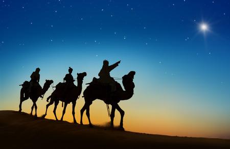 Three kings looking at the star. Stockfoto