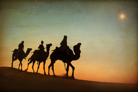 camel silhouette: Three kings looking at the star. Stock Photo
