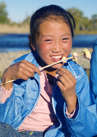 independent mongolia: Happiness Asian girl with her sweets. Stock Photo