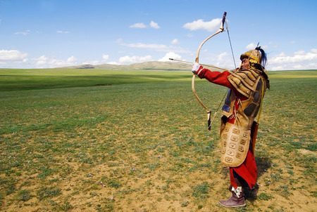 independent mongolia: Full armored archer aiming to shoot.