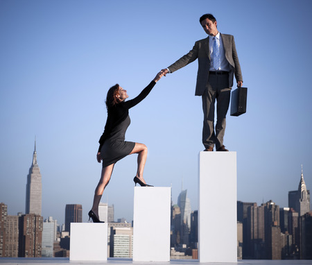 Businessman helping a colleague to succeed.  Stock Photo