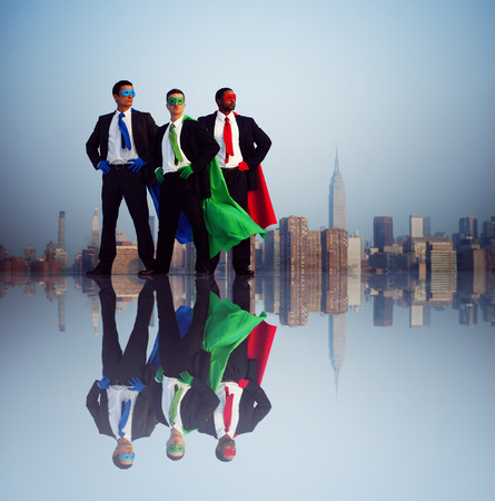 partnership power: Superhero businessmen infront of New York City