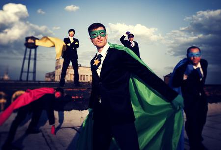 unity is strength: Multi-ethnic superhero businessmen. Stock Photo