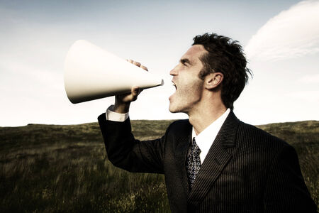 stating: Businessman shouting on the field.