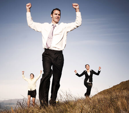 achivement: Concept of business people running on the mountain. Stock Photo