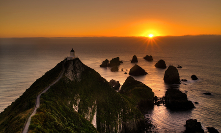 Sunset at Nugget Point, New Zealand South island photo
