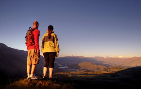 Adventurists enjoyong a beautiful sunrise, Queenstown, New Zealand. photo
