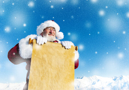 Traditional Santa Claus with a paper scroll. photo