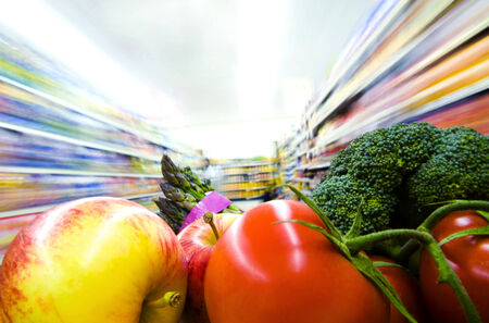 Fresh fruits and vegetables in a supermarket. photo