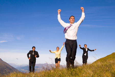 Business people running on the mountains.  photo