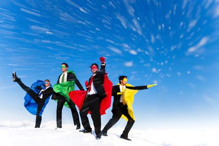 heros: Business superheros posing fighting moves in blizzard  Stock Photo