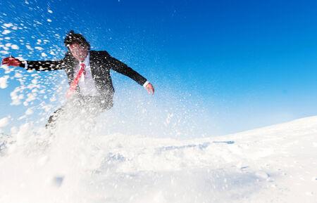 Businessman snow boarding. photo