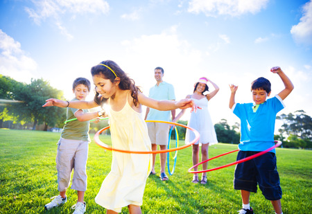 healthy exercise: Family spending quality time in the park.  Stock Photo