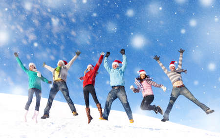 Group of friends jumping in the snow. photo