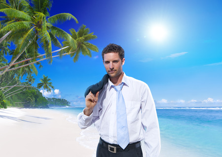 Businessman on tropical beach. photo