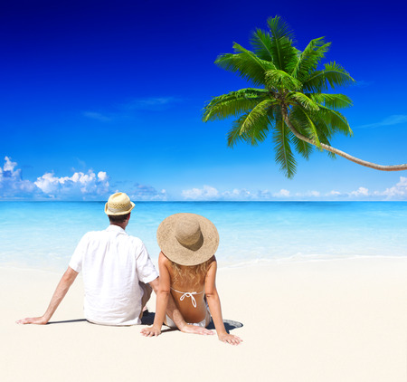serene people: Couple relaxing on the beach. Stock Photo